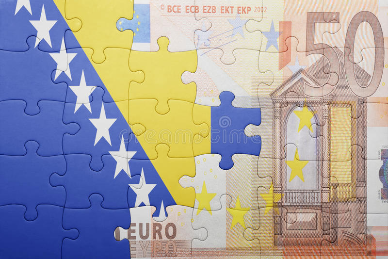 Puzzle with the national flag of bosnia and herzegovina and euro banknote. Concept stock photo