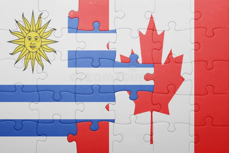 Puzzle with the national flag of canada and uruguay. Concept stock images