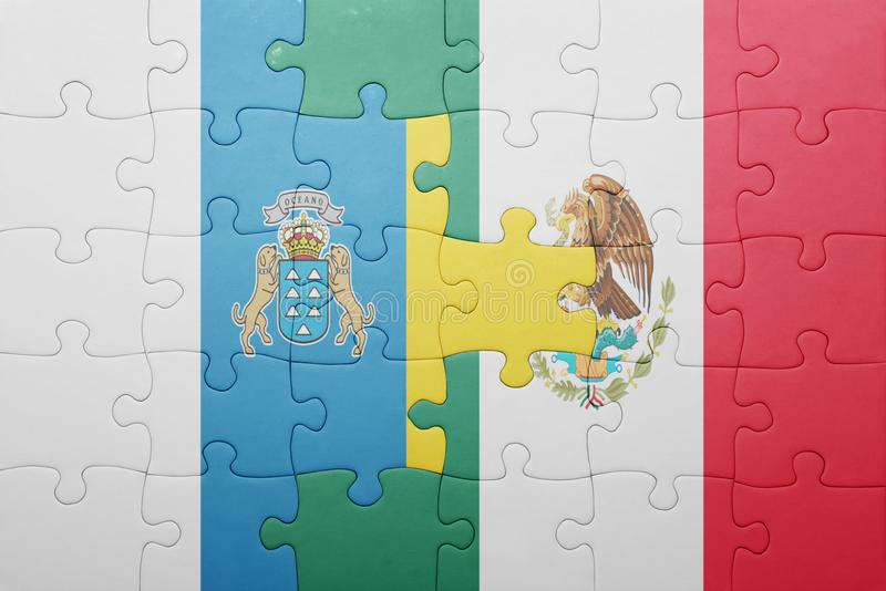 Puzzle with the national flag of canary islands and mexico. Concept stock photography