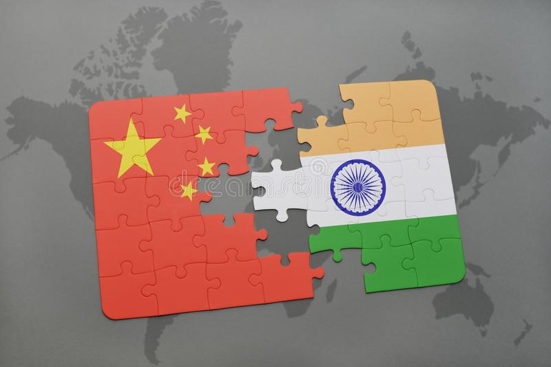 Puzzle with the national flag of china and india on a world map background. 3D illustration stock photo