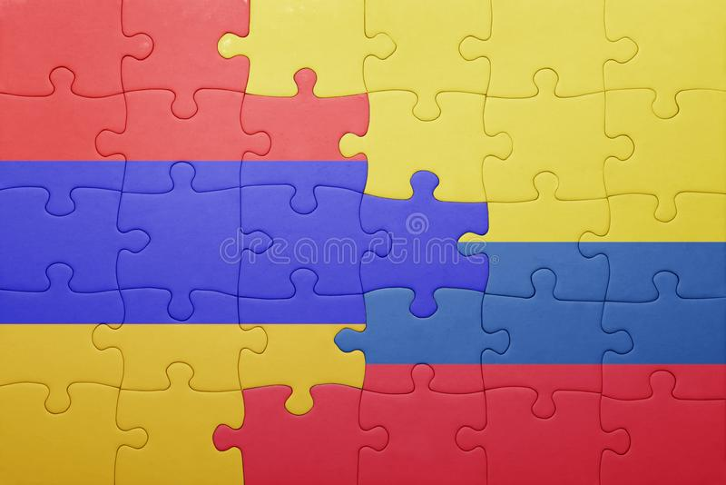 Puzzle with the national flag of colombia and armenia. Concept stock photos