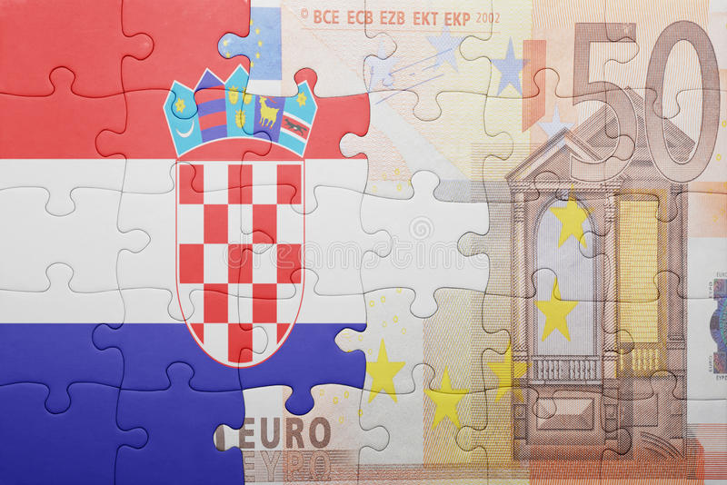 Puzzle with the national flag of croatia and euro banknote. Concept royalty free stock image