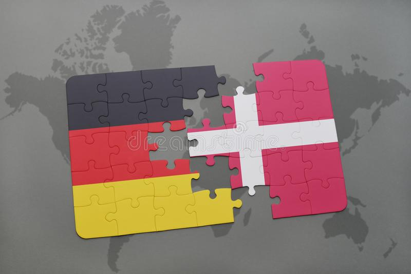 Puzzle with the national flag of germany and denmark on a world map background. 3D illustration royalty free stock photo