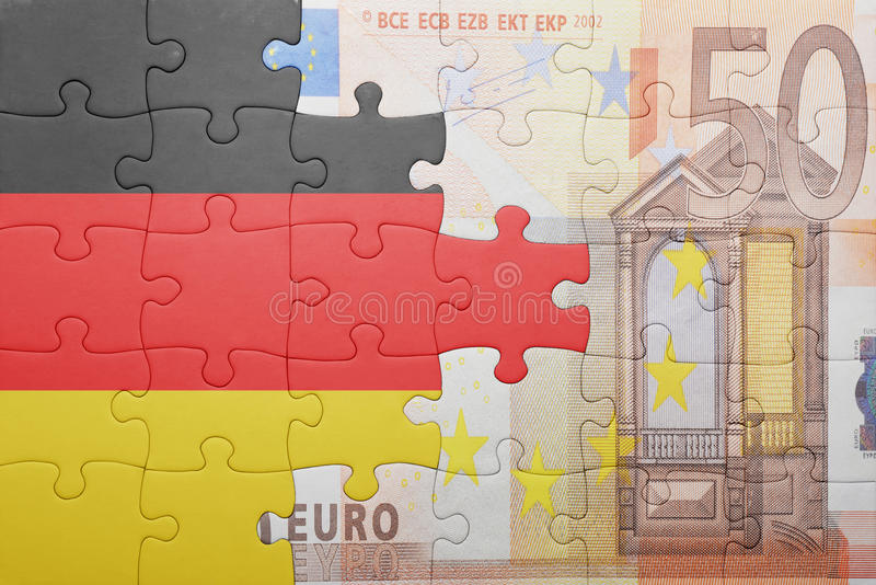 Puzzle with the national flag of germany and euro banknote. Concept stock image