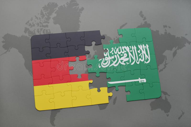 puzzle with the national flag of germany and saudi arabia on a world map background. stock photo