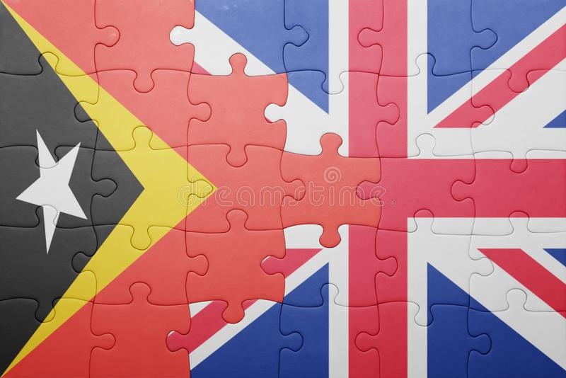 Puzzle with the national flag of great britain and east timor. Concept royalty free stock photography
