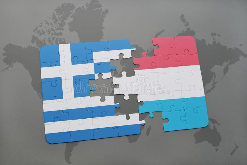 Puzzle with the national flag of greece and luxembourg on a world map background. 3D illustration royalty free stock photo