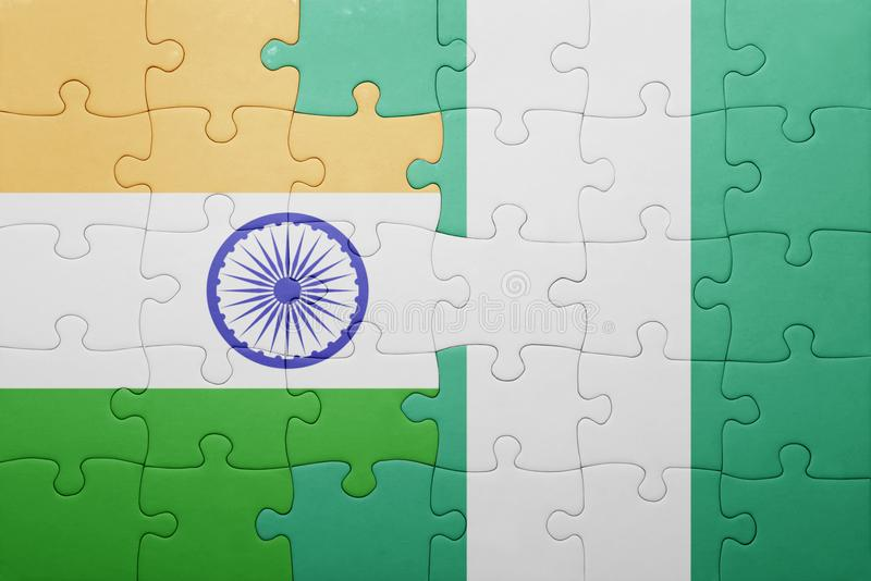 Puzzle with the national flag of india and nigeria. Concept stock photo