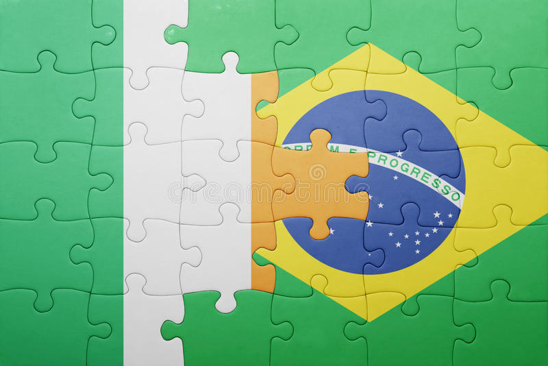 Puzzle with the national flag of ireland and brazil. Concept royalty free stock photos