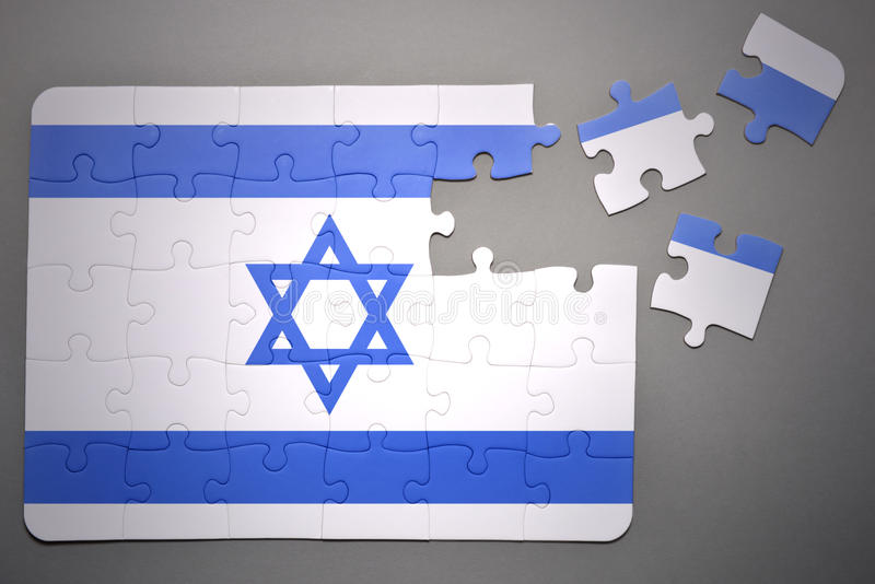 Puzzle with the national flag of israel. Broken puzzle with the national flag of israel on a gray background royalty free illustration