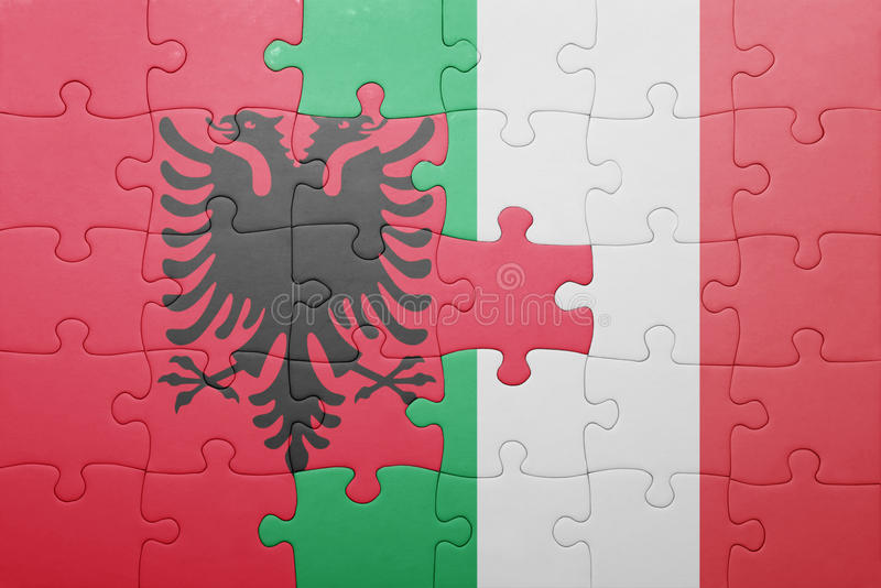 Puzzle with the national flag of italy and albania. Concept royalty free stock photography