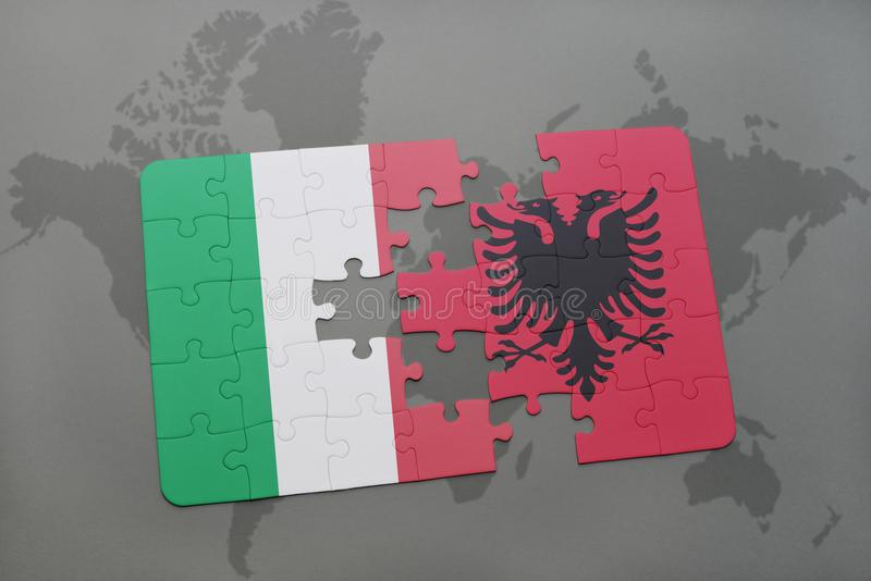 Puzzle with the national flag of italy and albania on a world map background. 3D illustration stock photo
