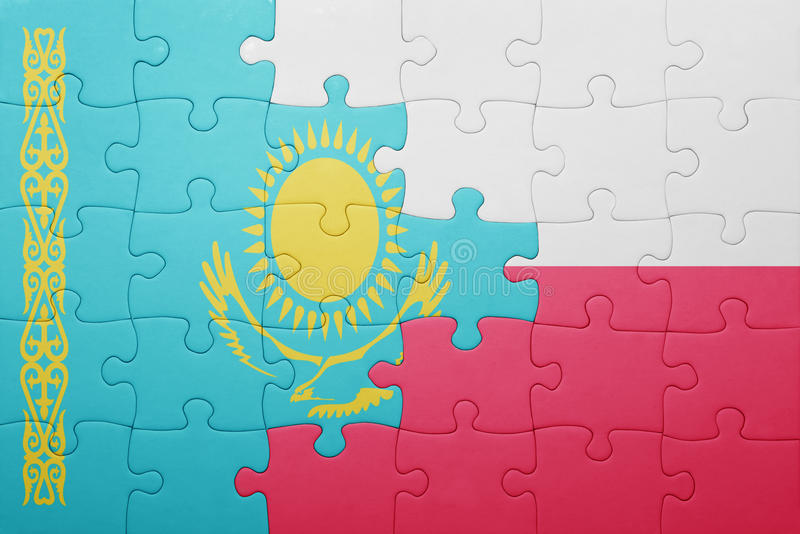 Puzzle with the national flag of kazakhstan and poland royalty free stock image