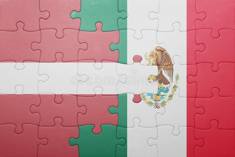 Puzzle with the national flag of latvia and mexico. Concept stock photos