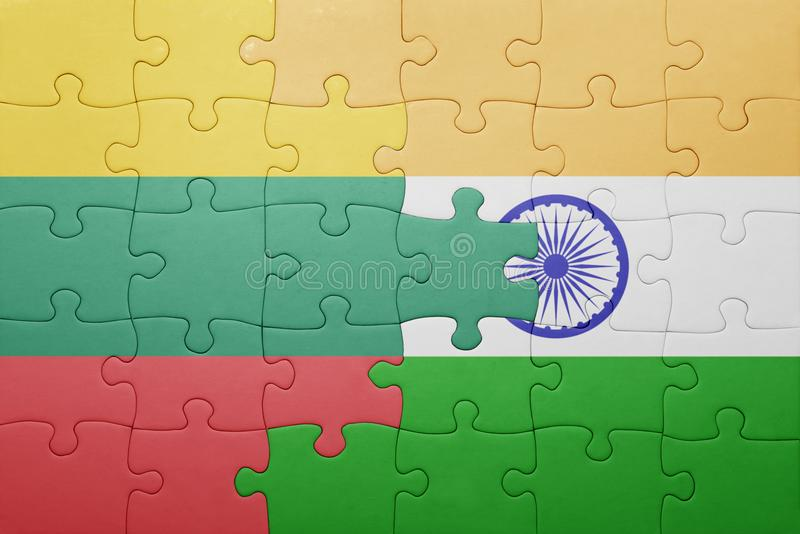 Puzzle with the national flag of lithuania and india. Cotncept stock images