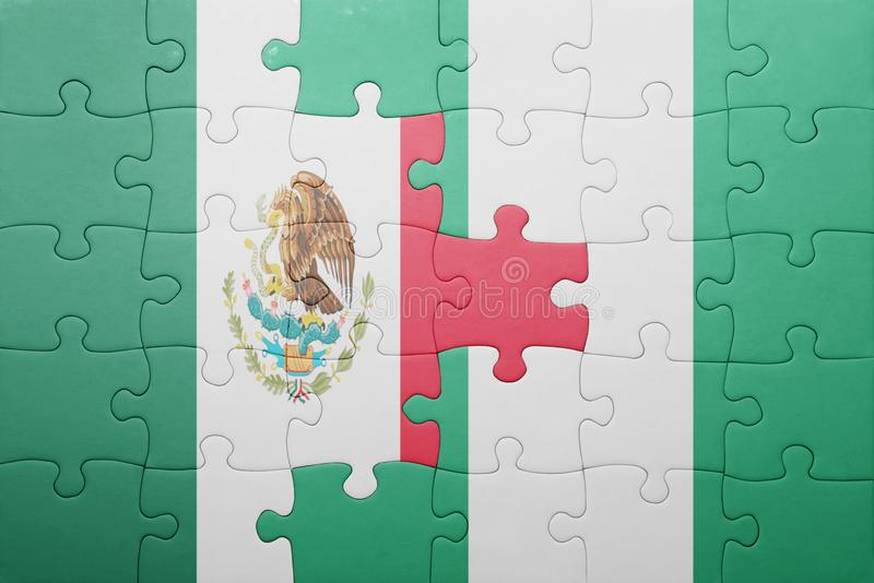 Puzzle with the national flag of mexico and nigeria. Concept royalty free stock image