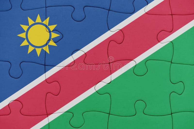 Puzzle with the national flag of namibia stock illustration