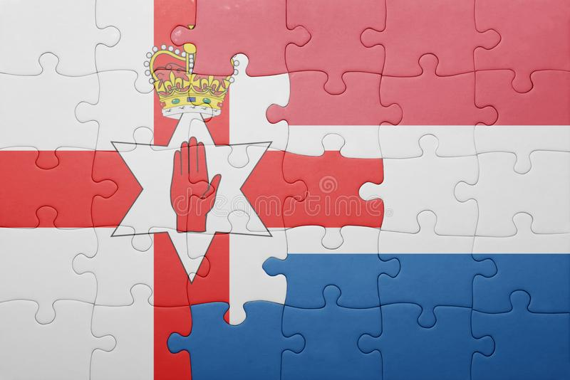 Puzzle with the national flag of netherlands and northern ireland. Concept royalty free stock photo