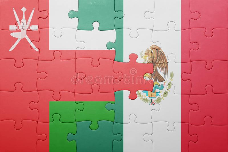 Puzzle with the national flag of oman and mexico. Concept stock photo