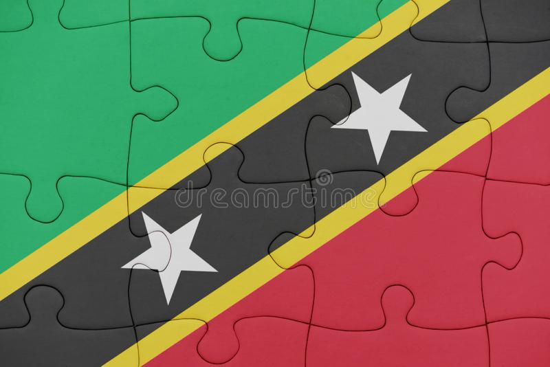 Puzzle with the national flag of saint kitts and nevis. Concept stock image