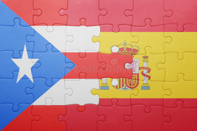 Puzzle with the national flag of spain and puerto rico. Concept stock photos