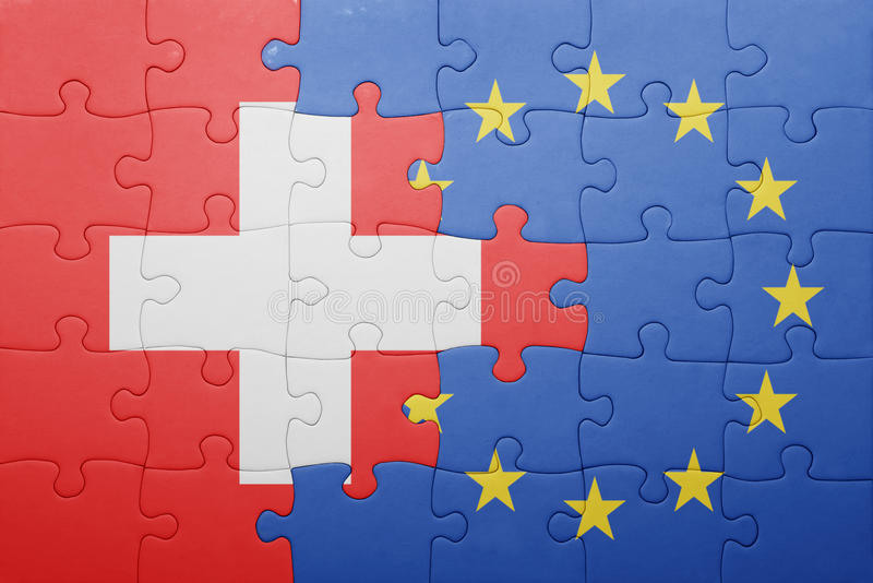 Puzzle with the national flag of switzerland and european union. Concept royalty free stock photos