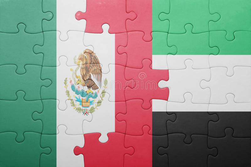 Puzzle with the national flag of united arab emirates and mexico. Concept royalty free stock photo