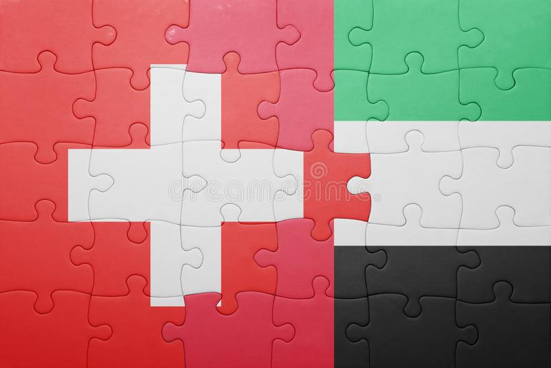 Puzzle with the national flag of united arab emirates and switzerland. Concept royalty free stock photos