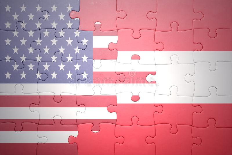 Puzzle with the national flag of united states of america and austria. Concept royalty free stock photo