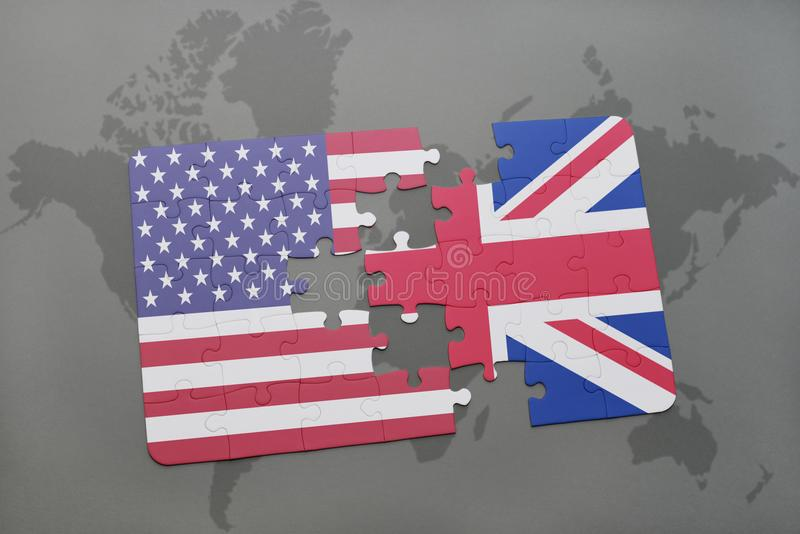 Puzzle with the national flag of united states of america and great britain on a world map background stock photography