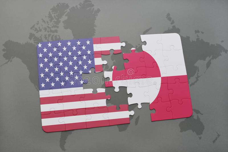 Puzzle with the national flag of united states of america and greenland on a world map background. Concept royalty free stock images