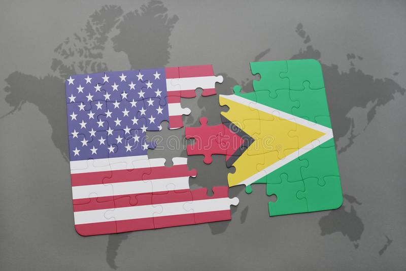 Puzzle with the national flag of united states of america and guyana on a world map background. Concept stock photos