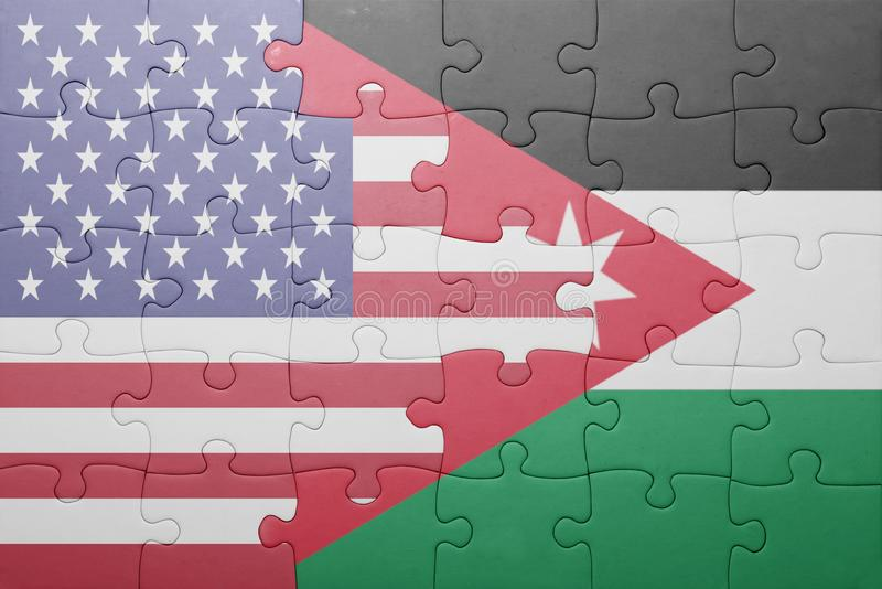 Puzzle with the national flag of united states of america and jordan. Concept stock images