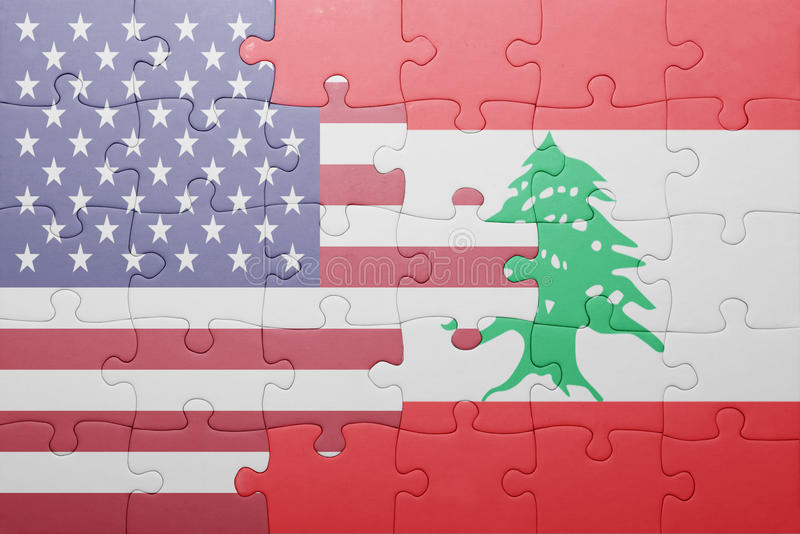 Puzzle with the national flag of united states of america and lebanon. Concept stock photos