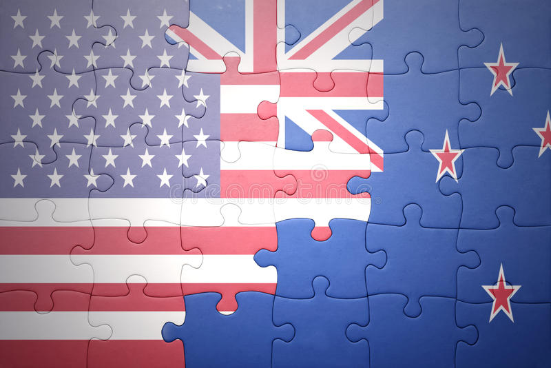 Puzzle with the national flag of united states of america and new zealand. Concept royalty free stock photography