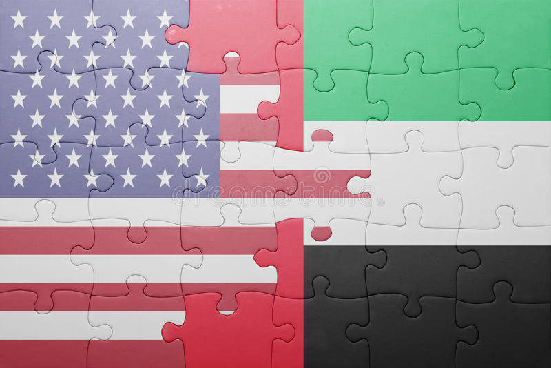 Puzzle with the national flag of united states of america and united arab emirates. Concept royalty free stock photo