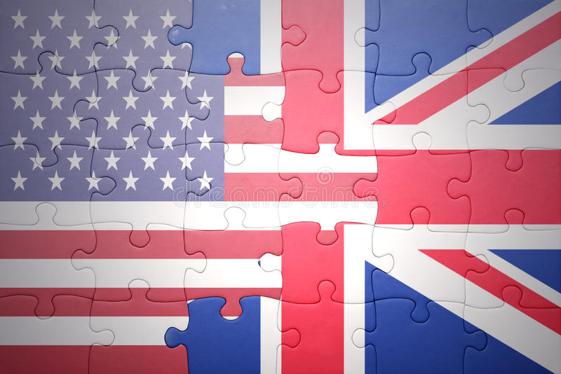 Puzzle with the national flags of united states of america and great britain royalty free stock image