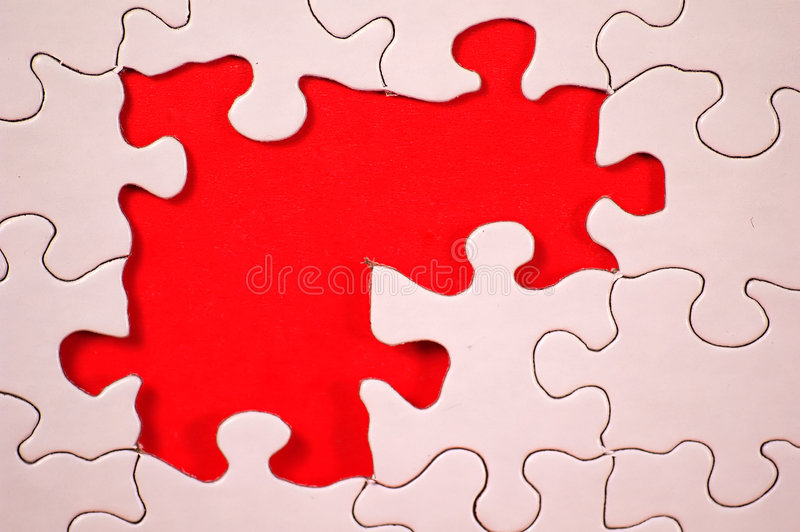 Puzzle With Orange Background. Photo of Puzzle With Orange Background. Partof Series stock photos