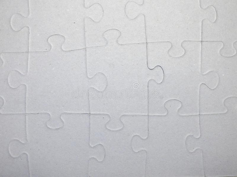 Puzzle pattern made of gray carton royalty free stock photo