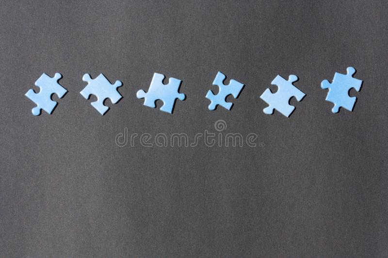Puzzle pieces on a dark background. royalty free stock photos