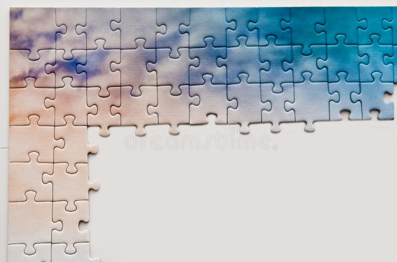 Puzzle pieces forming a frame with space for text stock images