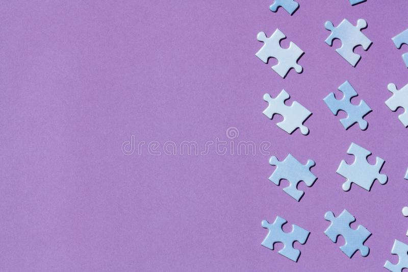 Puzzle pieces on a purple background. stock image