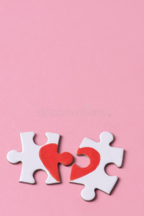 Puzzle pieces which form a heart royalty free stock image