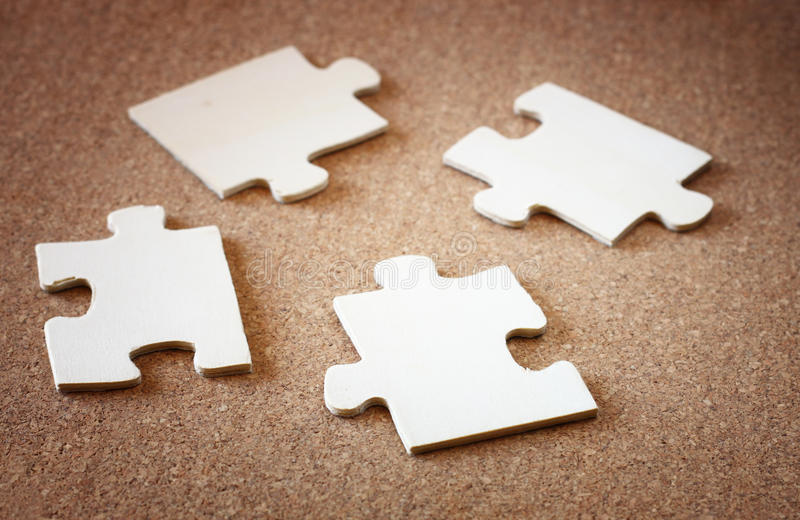 Puzzle pieces on wooden background. business or team concept. selective focus . stock photo