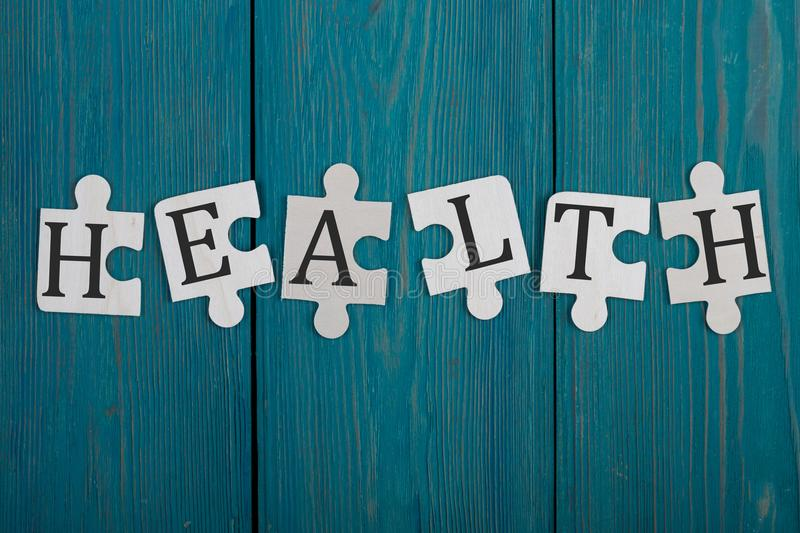 Puzzle pieces with word & x22;Health& x22; royalty free stock image