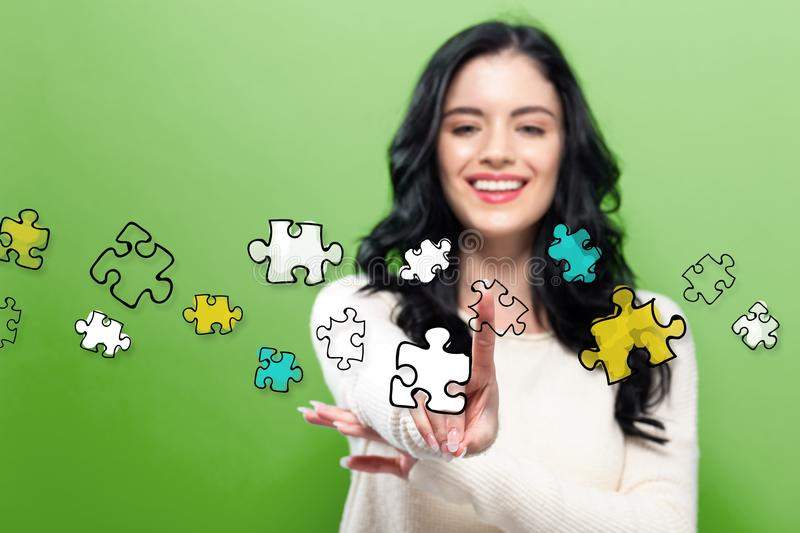 Puzzle Pieces with young woman stock photography