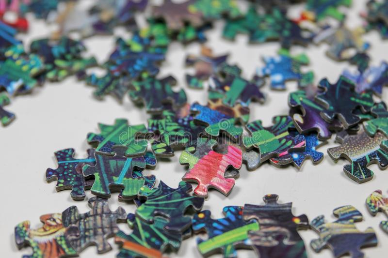 Puzzle and puzzle pieces stock images