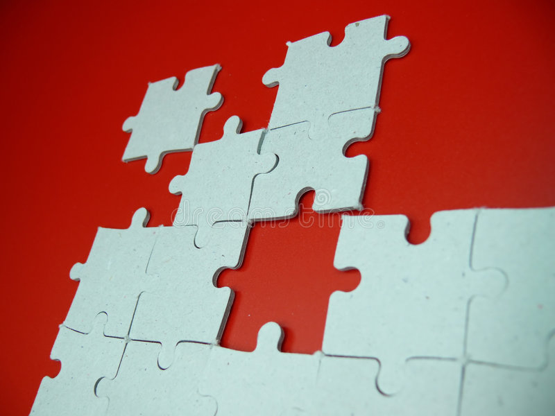 Puzzle On Red Royalty Free Stock Image