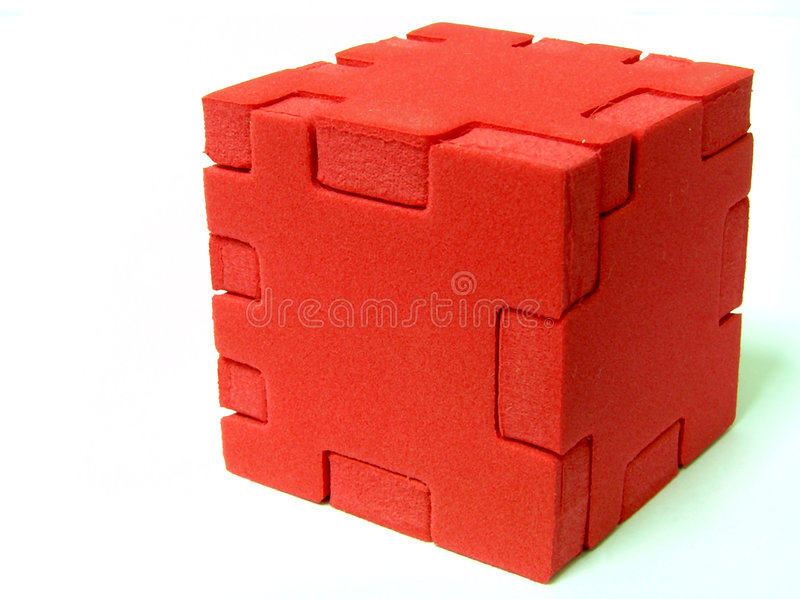 Puzzle - RED. A sponge cube puzzle with white colour background. This image can be used for teamwork or integration between parties/software
