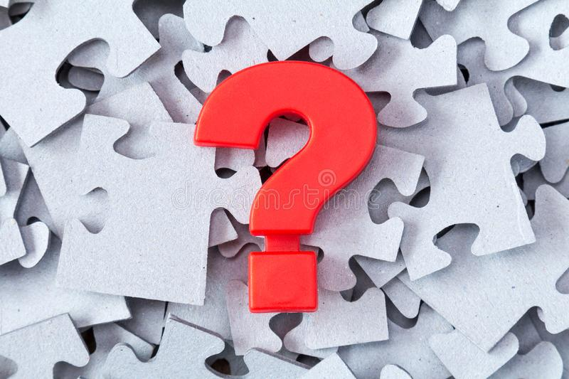 Puzzle and red question mark royalty free stock photo
